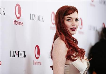 """Actress Lindsay Lohan arrives for a private dinner celebrating the upcoming premiere of """"Liz & Dick"""" at the Beverly Hills Hotel in Beverly Hills, California November 20, 2012. """"Liz & Dick"""" is a television film starring Lohan as actress Elizabeth Taylor. REUTERS/Jason Redmond"""