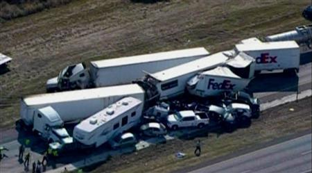 A pileup of 80 to 100 vehicles on a foggy Texas interstate near Beaumont, is pictured in this still image taken from video courtesy of KPRC-TV, November 22, 2012. The pileup in the eastbound lane of Interstate 10 near Beaumont shut down the highway in both directions and injured at least 51 people, eight critically, officials said. REUTERS/KPRC-TV/Handout