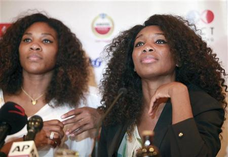 U.S tennis players Serena Williams (L) and Venus Williams look on during a news conference in Nigeria's commercial capital Lagos October 31, 2012. REUTERS/Akintunde Akinleye