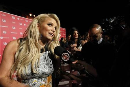 Actress and honoree Jessica Simpson is interviewed at the US Weekly Hot Hollywood Style issue party in Hollywood, California April 26, 2011. REUTERS/Mario Anzuoni
