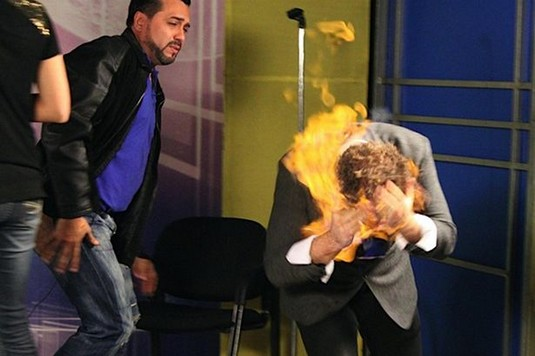 Magician's FACE set on fire when TV host rubs flaming liquid on him