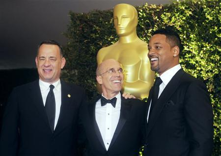 DreamWorks Animation Studio Executive Jeffrey Katzenberg, (C) who is due to receive the Jean Hersholt Humanitarian Award at the Academy of Motion Picture Arts & Sciences 4th annual Governors Awards, poses with actors Tom Hanks (L) and Will Smith at the event December 1, 2012 in Hollywood. REUTERS/Fred Prouser
