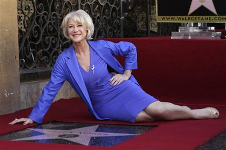 """Helen Mirren poses with her newly-unveiled star, the 2,488th star on the Hollywood Walk of Fame, in Hollywood, California, January 3, 2013. The multi major award-winning actress was recently nominated for a Golden Globe Award by the Hollywood Foreign Press Association for Best Actress in a Motion Picture: Drama and for a Screen Actors Guild Award for Best Actress in a Motion Picture Drama. Mirren will appear in the HBO biopic """"Phil Spector"""" later this year. REUTERS/David McNew"""