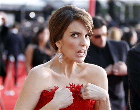 Actress Tina Fey adjusts her dress as she arrives at the 17th annual Screen Actors Guild Awards in Los Angeles, California January 30, 2011. REUTERS/Lucas Jackson