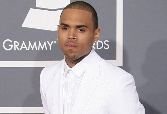 'He Loves Her': Chris Brown 'Hurt' Over Rihanna Fan Attack In London