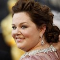 "McCarthy, best supporting actress nominee for her role in ""Bridesmaids"", arrives at the 84th Academy Awards in Hollywood"