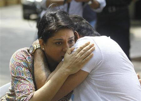 Bollywood actor Sanjay Dutt (R) embraces his sister Priya Dutt after breaking down during a news conference outside his residence in Mumbai March 28, 2013. REUTERS/Stringer