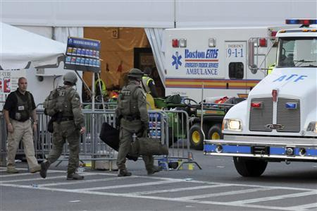 Agents from several federal agencies including the FBI and ATF arrive on scene after explosions near the finish line of the Boston Marathon in Boston, Massachusetts April 15, 2013. REUTERS/Neal Hamberg