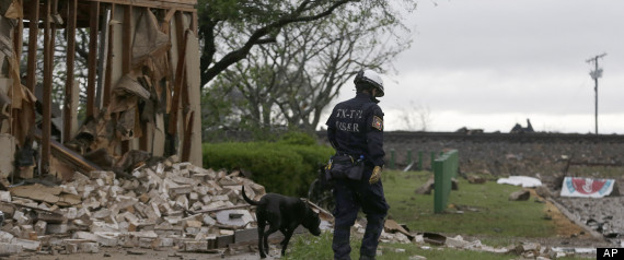 A search and rescue dog is led through the blast zone destroyed by an explosion at a fertilizer plant in West, Texas, Thursday, April 18, 2013.  A massive explosion at the West Fertilizer Co. killed as many as 15 people and injured more than 160, officials said overnight.  The explosion that struck around 8 p.m. Wednesday, sent flames shooting into the night sky and rained burning embers and debris down on shocked and frightened residents.  (AP Photo/LM Otero)