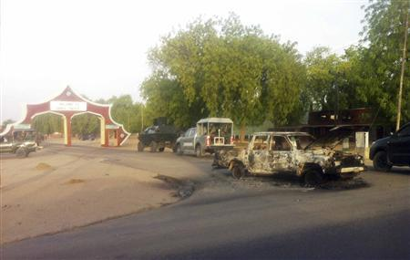 Military vehicles approach the entrance of the Shehu's Palace of Bama, Maiduguri, Borno State, Nigeria. May 7, 2013. REUTERS/Stringer
