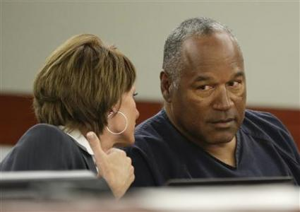 O.J. Simpson (R) sits with his attorney, Patricia Palm in Clark County District Court during his evidentiary hearing in Las Vegas, Nevada May 13, 2013. REUTERS/Julie Jacobson/Pool