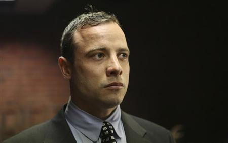 Oscar Pistorius enters the dock before in court proceedings at the Pretoria Magistrates court June 4, 2013. REUTERS/Siphiwe Sibeko