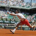 Rafael Nadal of Spain hits a return to Novak Djokovic of Serbia during their men's singles semi-final match at the French Open tennis tournament at the Roland Garros stadium in Paris June 7, 2013. REUTERS/Gonzalo Fuentes