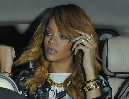 Rihanna is bundled into a car following her night out (Splash News)