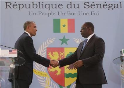 U.S. President Barack Obama (L) and Senegal President Macky Sall shake hands after their joint news conference at the Presidential Palace June 27, 2013 in Dakar, Sengal. REUTERS/Gary Cameron