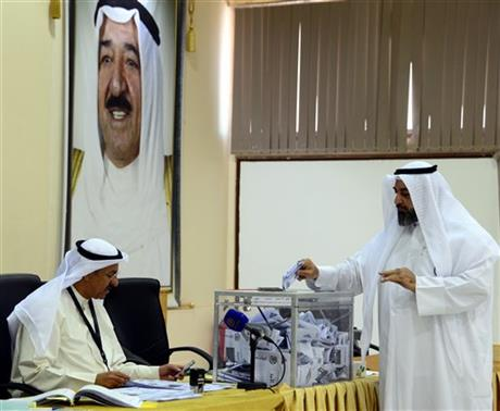 A Kuwaiti man cast his vote at a polling station in Rumaithiya