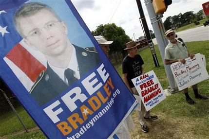 FILE - In this July 30, 2013 file photo, supporters of Army Pfc. Bradley Manning protest outside of the gates at Fort Meade, Md. Manning was acquitted of aiding the enemy, the most serious charge he faced, but was convicted of espionage, theft and other charges, more than three years after he spilled secrets to WikiLeaks. Few Americans in living memory have emerged from obscurity to become such polarizing public figures _ admired by many around the world, fiercely denigrated by many in his homeland. (AP Photo/Jose Luis Magana, File)