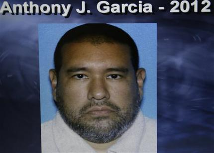 Dr. Anthony Garcia, 40, is pictured in this photo released by the Omaha Police. Omaha Police Chief Todd Schmaderer said that Garcia was arrested Monday, July 15, 2013, in Illinois. Garcia has been linked to both the May 2013 Omaha slayings of 65-year-old Roger Brumback and 65-year-old Mary Brumback and the 2008 stabbing deaths of an 11-year-old Thomas Hunter and his family housekeeper, 57-year-old Shirlee Sherman. The slain Brumback and Hunter fired Garcia in 2001 when he was a pathology resident at Creighton Medical School. (AP Photo/Omaha Police)