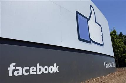 This Tuesday, July 16, 2013, photo, shows a sign seen at Facebook headquarters in Menlo Park, Calif. Facebook reports quarterly earnings on Wednesday, July 24, 2013. (AP Photo/Ben Margot)