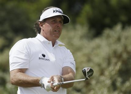 Phil Mickelson of the United States watches his drive off the third tee during the final round of the British Open Golf Championship at Muirfield, Scotland, Sunday July 21, 2013. (AP Photo/Jon Super)