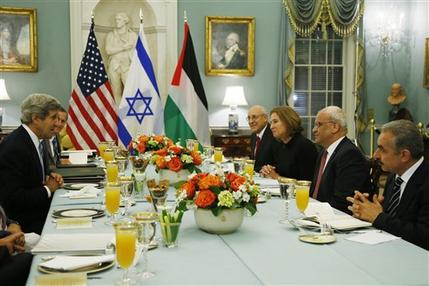 Secretary of State John Kerry, left, sits across from Israel's Justice Minister and chief negotiator Tzipi Livni, third right, Palestinian chief negotiator Saeb Erekat, second right, Yitzhak Molcho, an adviser to Israeli Prime Minister Benjamin Netanyahu, fourth right, and Mohammed Shtayyeh, aide to Palestinian President Mahmoud Abbas, right, at an Iftar dinner, which celebrates Ramadan, at the State Department in Washington, marking the resumption of Israeli-Palestinian peace talks, Monday, July 29, 2013. (AP Photo/Charles Dharapak)