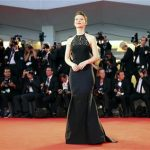 Actress Mia Wasikowska poses during a red carpet at the 70th Venice Film Festival in Venice
