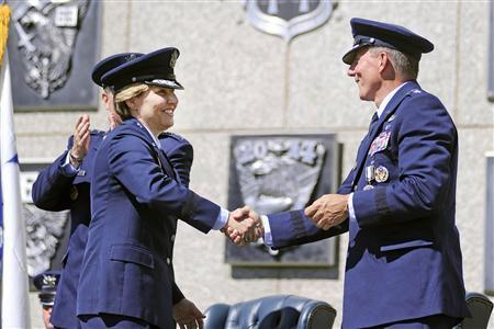 Handout photo of newly-named superintendent of the United States Air Force Academy Lt. Gen. Michelle Johnson shaking hands with Lt. Gen. Mike Gould in Colorado