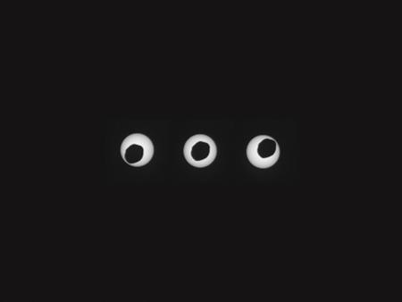 Phobos, the larger of Mars' two moons, is pictured in the midst of an annular eclipse of the sun
