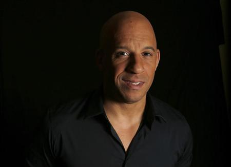 """Diesel poses for a portrait while promoting his upcoming movie """"Riddick"""" in Los Angeles"""