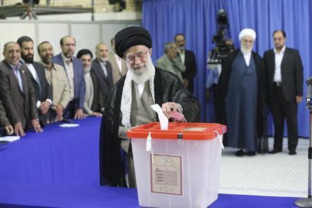 Iran's Supreme Leader Ayatollah Ali Khamenei casts his ballot at his office in central Tehran