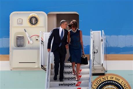 President Barack Obama, accompanied by first lady Michelle Obama
