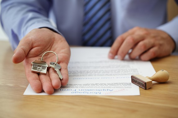 Real estate agent handing over