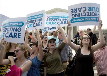 Supporters of the Affordable Healthcare Act celebrate after the court upheld the legality of the law in Washington