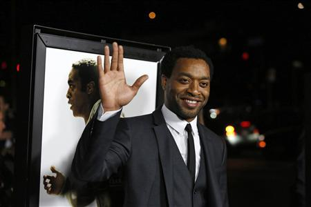 """Cast member Ejiofor waves at a special screening of """"12 Years a Slave"""" at the Directors Guild of America in Los Angeles"""