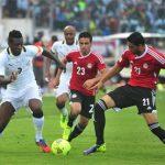 Ghana's Asamoah Gyan, left, battles with Egypt's Mohamed Naguib and Ahmed Shedid, right