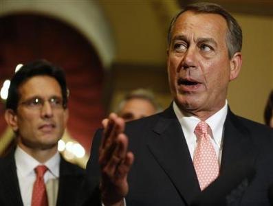 Speaker of the House Boehner speaks to the news media with U.S. House Majority Leader Cantor (R-VA) at his side in Washington