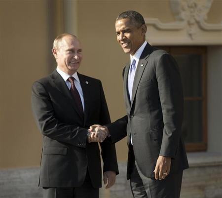 U.S. President Barack Obama and Russia's President Vladimir Putin shake hands during arrivals for the G20 summit at the Konstantin Palace in St. Petersburg