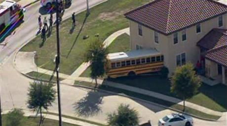 bus that crashed into a house at Joint Base San Antonio-Fort Sam Houston