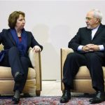 EU foreign policy chief Ashton talks with Iranian Foreign Minister Zarif during photo opportunity before the start of three days of closed-door nuclear talks at the UN in Geneva