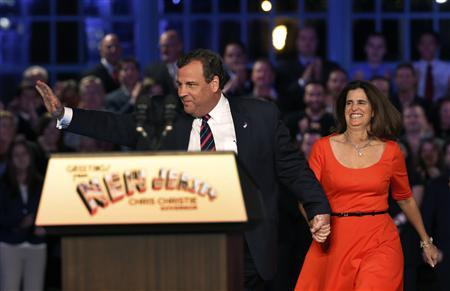 Republican New Jersey Governor Chris Christie takes the stage with his wife Mary Pat at his election night party in Asbury Park, New Jersey