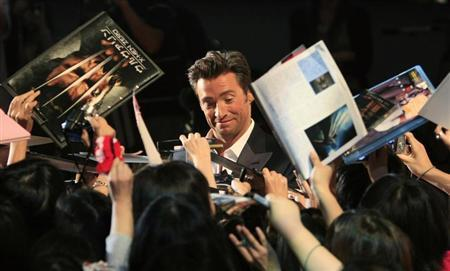 Actor Jackman signs autographs for fans at the Japan premiere of X-men Origins: Wolverine in Tokyo