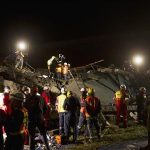 Emergency workers search for survivors after a building collapsed in Tongaat