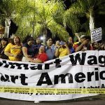 People take part in a protest for better wages outside Wal-mart in Los Angeles