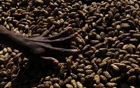 A woman arranges peanuts at the main markets in Honiara