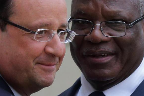 French President Hollande welcomes Ibrahim Boubacar Keita, President of Mali, as he arrives at the Elysee Palace in Paris