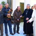 Pope Francis, right, prepares to meet homeless people