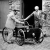 Henry Ford, right, stands with his first car built in 1892