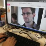 A picture of Snowden, a contractor at the NSA, is seen on a computer screen displaying a page of a Chinese news website, in Beijing in this photo illustration