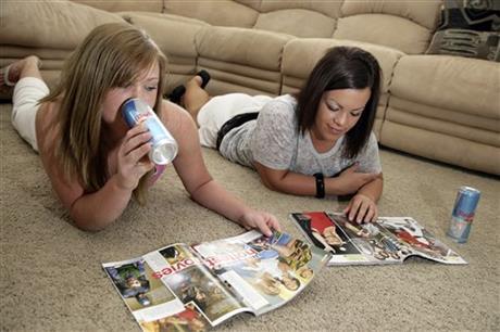 Megan Ward, left, drinks an energy drink with her friend Mykel Prescott
