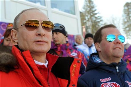 Russian President Vladimir Putin, left, and Premier Dmitry Medvedev